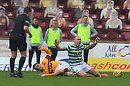 Tony Watt (Motherwell) brings down Scott Brown (Celtic) in front of Andrew Dallas (referee) during the Scottish Premiership match between Motherwell and Celtic at Fir Park, Motherwell, Scotland on 8 November 2020.