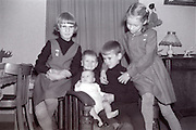 family moment children posing with baby 1960s