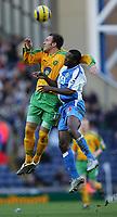 Photo. Andrew Unwin, Digitalsport<br /> Blackburn Rovers v Norwich, Barclays Premiership, Ewood Park, Blackburn 12/02/2005.<br /> Norwich's Dean Ashton (L) outjumps Blackburn's Aaron Mokoena (R).