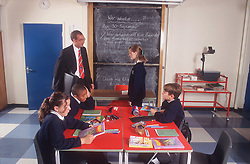 Secondary school lesson with teacher and pupils,