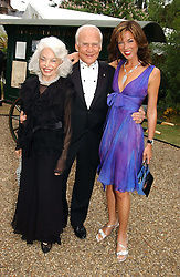 Left to right, MR & MRS BUZZ ALDRIN the 2nd man to walk on The Moon and HEATHER KERZNER wife of Sol Kerzner at a fund raising event for The Galapagos Conservation Trust entitled 'Some Enchanted Evening' at the Chelsea Physic Garden Chelsea, London on 17th June 2004.