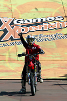 """Jul 01, 2003; Anaheim, California, USA; Moto X star athlete MIKE METZGER shows who is #1 at the opening of Disney's California Adventure """"X Games Experience"""".  Disney park has built two X-Arena's specifically for this 41 day event highlighting extreme sports for the launch of the 2003 ESPN X Games.<br />Mandatory Credit: Photo by Shelly Castellano/Icon SMI<br />(©) Copyright 2003 by Shelly Castellano"""