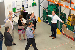 FareShare Kent Development Manager Ian Townsend-Blazier explains the workings of the warehouse to guests at the opening of FareShare's relocated warehouse in Ashford, Kent. Ashford, Kent, May 23 2019.