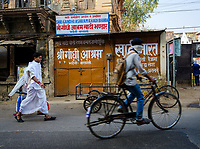 Varanasi, INDIA - CIRCA NOVEMBER 2018: People on the Streets of Varanasi. Varanasi is the spiritual capital of India, the holiest of the seven sacred cities and with that many rituals and offerings are performed daily by priests and hindus.