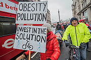 Stop Killing Cyclists stage a die-in to remember Anita Szucs, 30 and Karla Roman, 32 (both killed while cycling on Monday), and Ben Wales, 32. They are demanding investment in cycling and walking in the hope that it rises to 10% of the UK transport budget by the end of this parliament. They also point out that air pollution is poisoning millions of people in the UK and road danger means most people do not feel safe cycling on UK roads - meaning they miss out on healthy exercise and compounding a health disaster which the NHS will struggle to afford. They met outside the National Gallery and moved to the Treasury, Horse Guards Parade for protest.