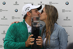29.06.2014, Golf Club Gut Laerchenhof, Pulheim, GER, BMW International Golf Open, im Bild Winner der BMW international Open 2014 Fabrizio Zanotti (PAR) mit Pokal und seiner Frau Lucia // during the International BMW Golf Open at the Golf Club Gut Laerchenhof in Pulheim, Germany on 2014/06/29. EXPA Pictures © 2014, PhotoCredit: EXPA/ Eibner-Pressefoto/ Kolbert<br /> <br /> *****ATTENTION - OUT of GER*****