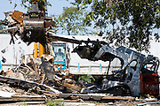 20 SEPTEMBER 2006 - NEW ORLEANS, LOUISIANA: Demolition crews tear down abandoned homes in the Lower 9th Ward of New Orleans, LA. The neighborhood was abandoned after flooding from nearby canals after Hurricane Katrina inundated this part of the city. Photo by Jack Kurtz / ZUMA Press
