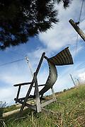 reclining wooden folding chair under a tree