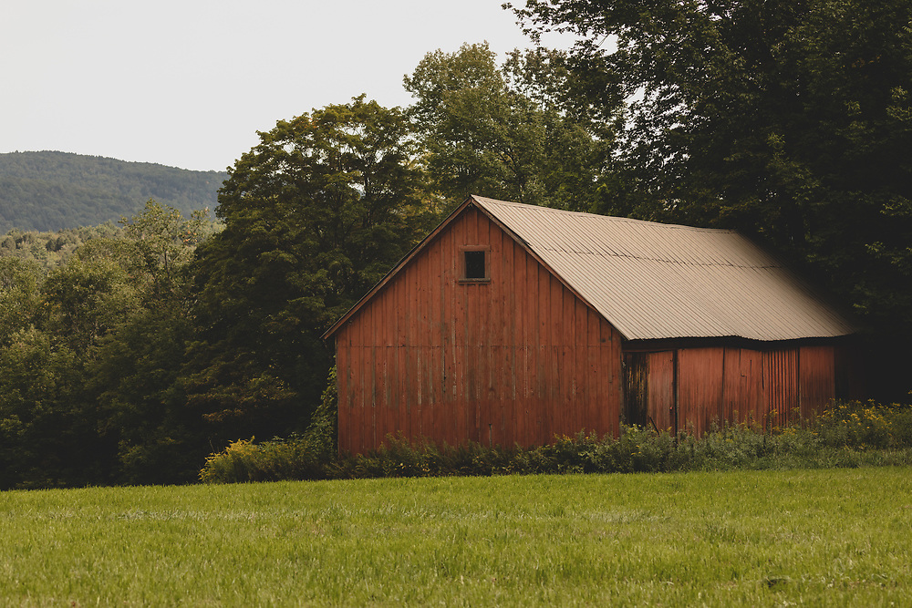 An old red barn nestled on a hilltop on the outskirts of Woodstock.