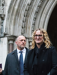 Royal Courts of Justice, London, February 8th 2017. As day two for the appeal hearing for 'Marine A' - Sgt Alex Blackman draws to a close, retired Marines and supporters gather on the steps of the High Court as his wife Claire emerges from the building. PICTURED: Claire Blackman emerges from the High Court.