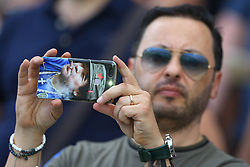 April 29, 2018 - Florence, Italy - Napoli supporter suing a mobile cover with the face of Diego Armando Maradona during the Serie A match between ACF Fiorentina and SSC Napoli at Stadio Artemio Franchi on April 29, 2018 in Florence, Italy. (Credit Image: © Matteo Ciambelli/NurPhoto via ZUMA Press)