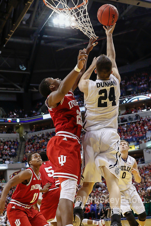 INDIANAPOLIS, IN - DECEMBER  20: Kellen Dunham #24 of the Butler Bulldogs shoots the ball against Stanford Robinson #22 of the Indiana Hoosiers at Bankers Life Fieldhouse on December 20, 2014 in Indianapolis, Indiana. Indiana defeated Butler 82-73. (Photo by Michael Hickey/Getty Images) *** Local Caption *** Kellen Dunham; Stanford Robinso