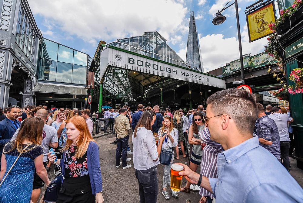 Stoney street is soon thronging with lunchtime eaters and drinkers - The market reopening is signified by the ringing of the bell and is attended by Mayor Sadiq Khan. Tourists and locals soon flood back to bring the area back to life. London  14 June 2017.