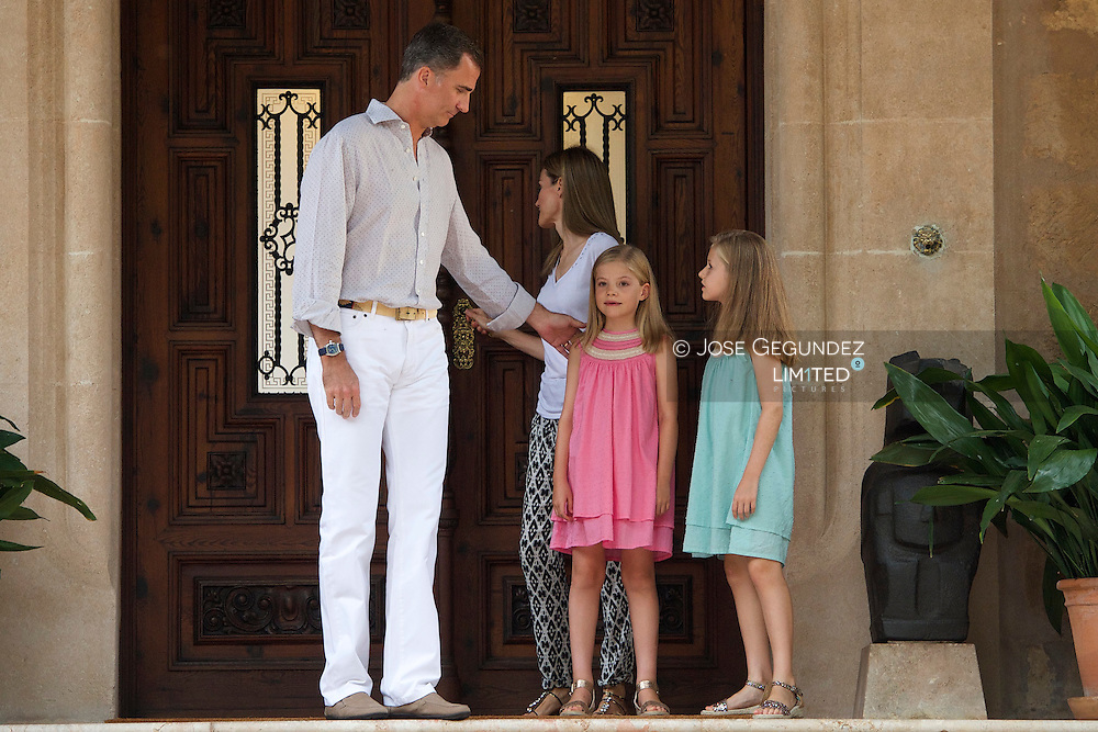 King Felipe VI of Spain, Queen Letizia of Spain, Princess Leonor and Princess Sofia pose for photographers at the door of Marivent Palace during their hollidays in Palma de Mallorca, on August 5, 2014 in Spain