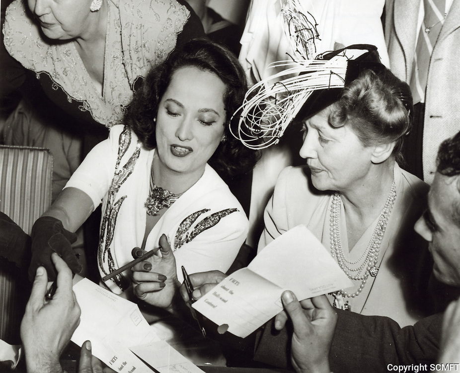 1944 Merle Obregon and Hedda Hopper sign autographs at the Hollywood Canteen