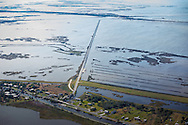 Island Road connecting Pointe-aux-Chenes with Isle de Jean Charles in Terrebonne Parish.<br /> Recent hurricanes hastened coastal erosion. Many resident have moved away. The area is the home of the Pointe-au-Chien Tribe.