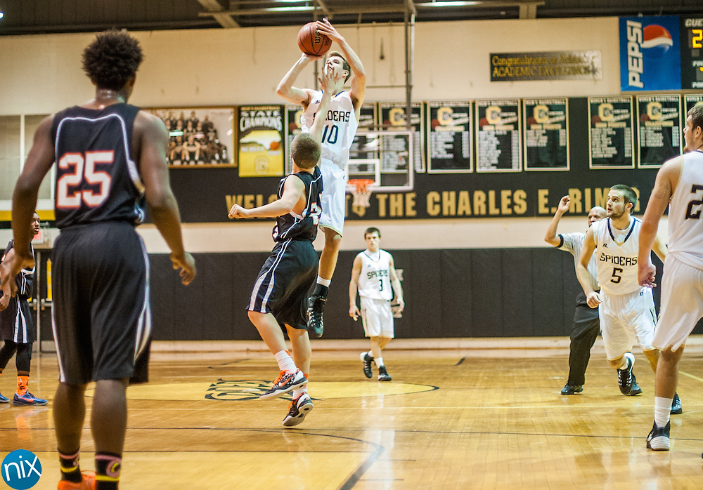 Concord's Connord Burchfield takes a three-point shot against Northwest Cabarrus Tuesday night at Concord High School. Concord won the game 89-49.