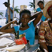 "Marie Yolene, Bois De Fer, age 44,  and daughter Marie Geralda Auguste, 17, in a camp opposite the Palace, Cham de Mars.  Marie's son Emanuel was trapped for 12 days before he was eventually rescued ( the New York Times did a feature on him). The daughter recounts: ""I was sitting down at the house when it started to rock then blocks and wood started falling, Romario broke his leg, Mum grabbed us all and we got out all except my oldest brother Emanual.  He was trapped. We weren't sure if he was alive or dead but we kept looking for him. Then my mother and Emanuel heard each other. He called out, 'Mamma I'm alive,' Mum told everybody she could find that he  was alive,  journalists, aid workers rescue workers, After 11 days rescuers ( an Israeli SAR) pulled him out, my mother collapsed from joy."""