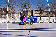 03 JANUARY 2021 - DES MOINES, IOWA: A Zamboni operator cleans the ice on the last day of skating at Brenton Skating Plaza in downtown Des Moines. The ice skating rink usually opens in late November and stays open through late February or March, depending on weather. Covid restrictions limited capacity to less than half, skaters were encouraged to social distance, and skaters were required to wear proper face masks. This year the rink was forced to close January 3, after only six weeks, because it wasn't possible to comply with COVID-19 restrictions and still be profitable. Restrictions caused by the Coronavirus pandemic have limited many public events this winter in Iowa.    PHOTO BY JACK KURTZ