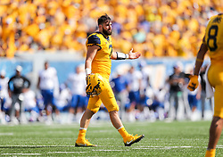 Oct 6, 2018; Morgantown, WV, USA; West Virginia Mountaineers quarterback Will Grier (7) reacts after being tackled during the third quarter against the Kansas Jayhawks at Mountaineer Field at Milan Puskar Stadium. Mandatory Credit: Ben Queen-USA TODAY Sports