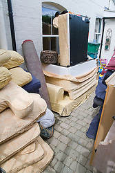 Damaged household goods and furniture piled up outside house after torrential rain caused the river Severn to bust its banks and flooded the Tewkesbury area; Gloucestershire; July 2007,