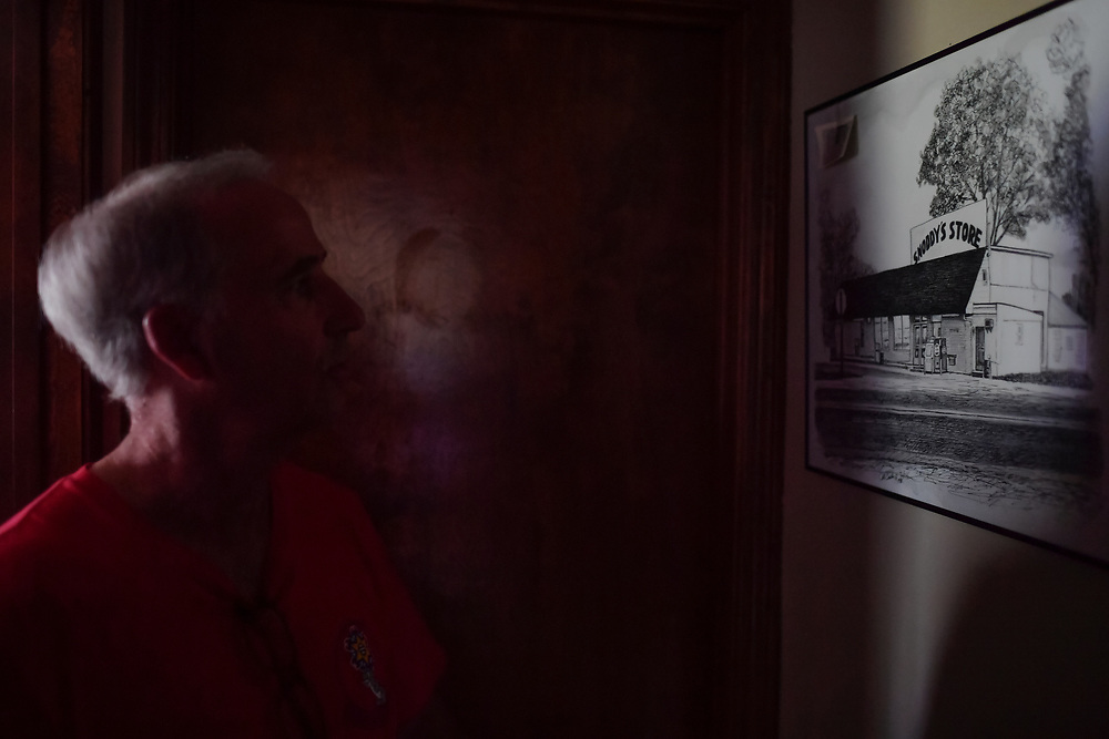 Jim Snoddy gazes at a drawing of the first Snoddy's building built by his great grandfather in 1924 inside his home. After the flood, the future of the store is far from certain.