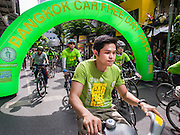 21 SEPTEMBER 2014 - BANGKOK, THAILAND: Bicyclists arrive at Bangkok Car Free Day event on Silom Road. Bangkok hosted Car Free Day 2014 Sunday. Silom Road, the major thoroughfare in Bangkok's financial district, was closed to cars so bicyclists could use the road. The event was to promote the use of mass transit and environmentally friendly means of transportation. About 20,000 people were expected to participate in a city wide bike riding rally.   PHOTO BY JACK KURTZ