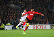 Fraizer Campbell of Cardiff City is tackled by Angel Rangel of Swansea City.<br /> Barclays Premier League match, Cardiff city v Swansea city at the Cardiff city stadium in Cardiff, South Wales on Sunday 3rd Nov 2013. pic by Phil Rees, Andrew Orchard sports photography,