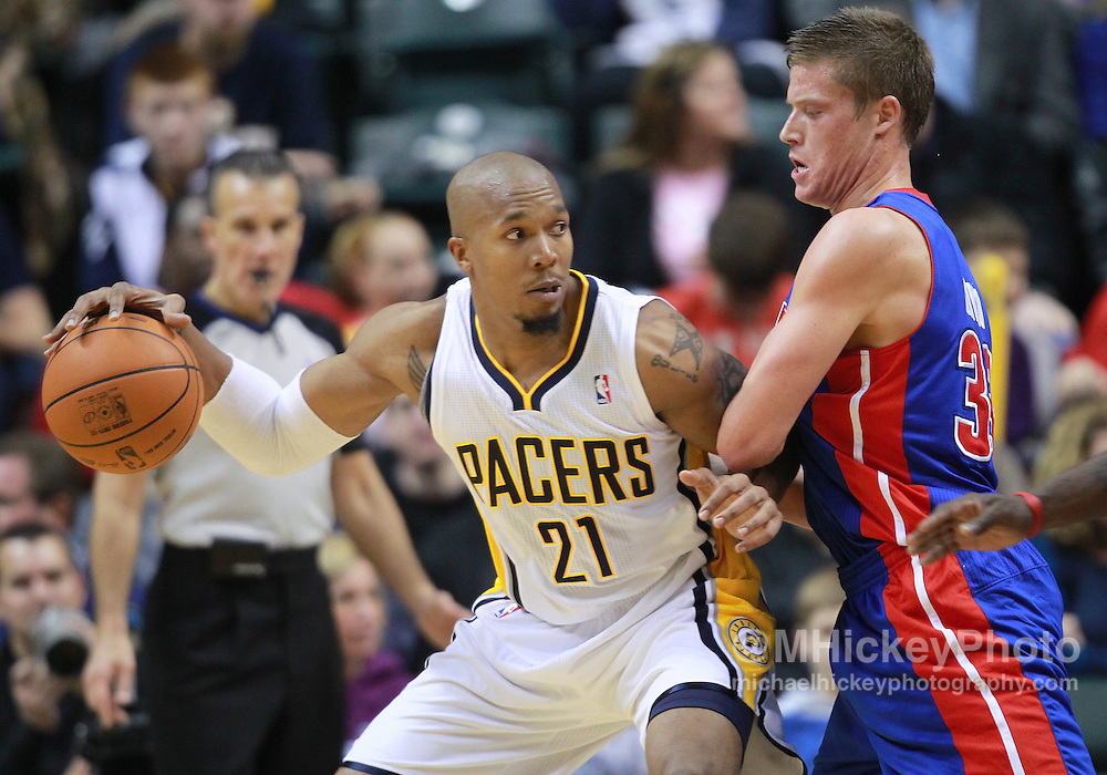 """Dec. 26, 2011; Indianapolis, IN, USA; Indiana Pacers power forward David West (21) dribbles against Detroit Pistons forward Jonas Jerebko (33) at Bankers Life Fieldshouse. Indiana defeated Detroit 91-79. Mandatory credit: Michael Hickey-US PRESSWIRE <a href=""""mailto:michael.hickey@me.com"""">Email Me</a>"""