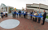 Mayor Ed Engler has the honor of the official ribbon cutting for the Laconia Main Street Bridge and Gateway Plaza Friday evening.  (Karen Bobotas/for the Laconia Daily Sun)