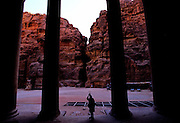 """A photographer inside the """"Treasury"""" at the entrance of Petra, which was recently named one of the """"Seven Modern Wonders of the World"""" - Jordan."""