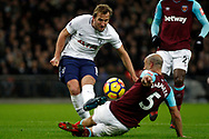 Pablo Zabaleta of West Ham United (R) tackles Harry Kane of Tottenham Hotspur (L) as he takes a shot at goal. Premier league match, Tottenham Hotspur v West Ham United at Wembley Stadium in London on Thursday  4th January 2018.<br /> pic by Steffan Bowen, Andrew Orchard sports photography.