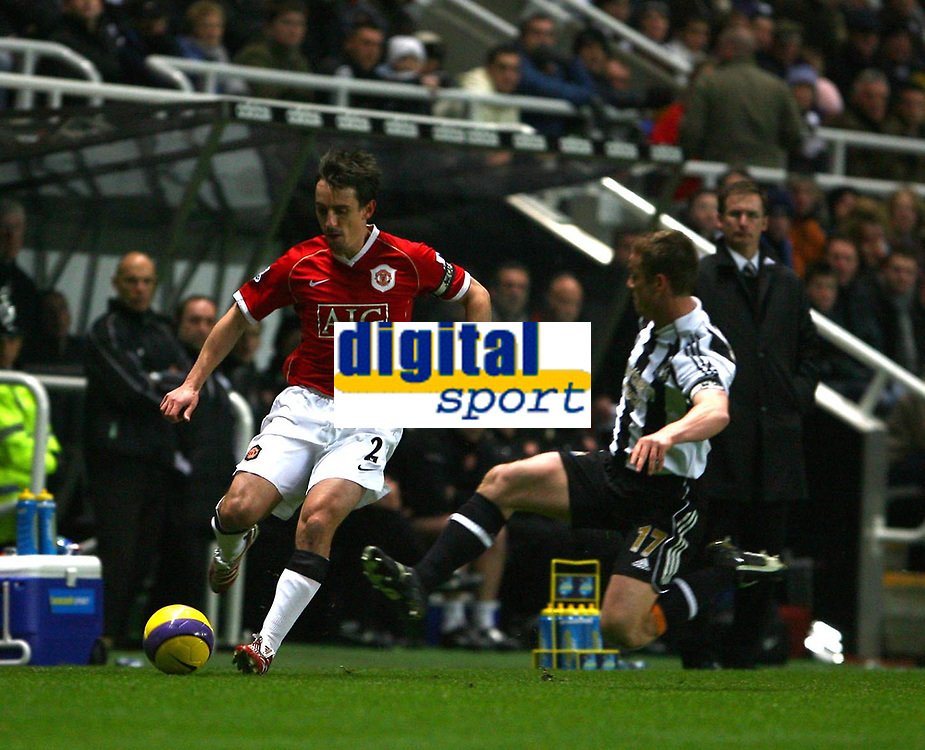 Photo: Andrew Unwin.<br /> Newcastle United v Manchester United. The Barclays Premiership. 01/01/2007.<br /> Newcastle's Scott Parker (R) looks to tackle Manchester United's Gary Neville (L).