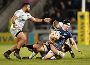 Sale Sharks flanker Ben Curry  is held by  Saracens centre Brad Barritt during the Aviva Premiership match Sale Sharks -V- Saracens at The AJ Bell Stadium, Salford, Greater Manchester, England on Friday, February 16, 2018. (Steve Flynn/Image of Sport)