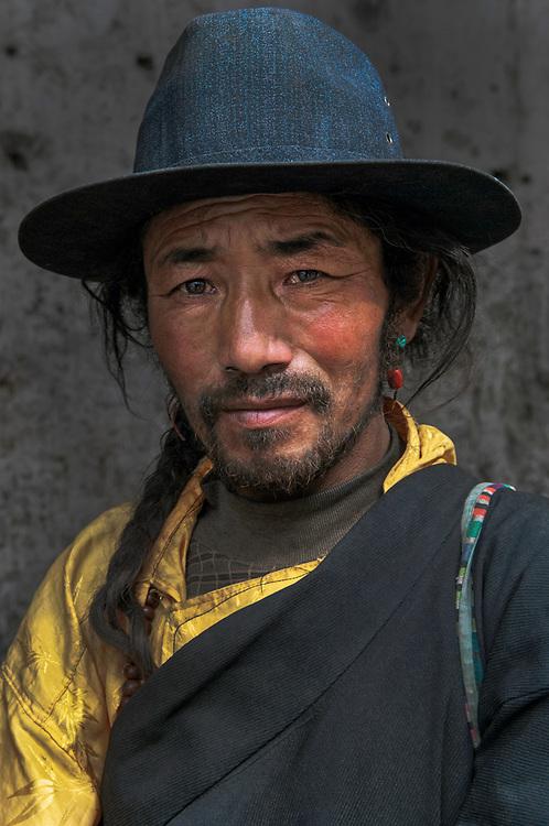 Tibetan buddhist pilgrim circumambulates the Barkhor Circuit around the sacred Jokhang Temple in Lhasa, Tibet