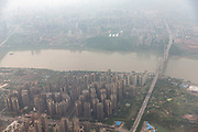 An aerial view of the city of Chongqing taken from a plane in Chongqing, China, on Tusday, April 12, 2016. The municipality of 30 million people saw state-led development approach fuelled the fastest pace nationwide, with President Xi Jinping praising policy innovations that have included subsidized housing and relaxed residency rules that encourage labor mobility.