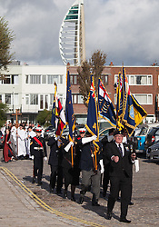 © Licensed to London News Pictures. 16/10/2016. Portsmouth, Hampshire, UK. Standard bearers taking part in the annual service for seafarers. Lord-Lieutenant of Hampshire, NIGEL ATKINSON and Lord Mayor of Portsmouth, Councillor DAVID FULLER, have taken part in the annual Seafarer's Service held at Portsmouth Cathedral, and the laying of wreaths at the statue of Lord Nelson. The service is held annually, on the first Sunday prior to the anniversary of the Battle of Trafalgar, 21st October, and remembers those who have lost their lives at sea, and also commemorates the life of Lord Horatio Nelson. Photo credit: Rob Arnold/LNP