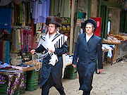 Jewish Orthodox men walk in the Old City, Jerusalem