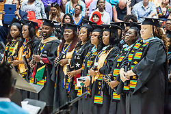School of Business students after receiving their degrees.  Fifty-first annual University of the Virgin Islands  Commencement Exercises.  UVI Sports & Fitness Center.  St. Thomas, VI.  14 May 2015.  © Aisha-Zakiya Boyd
