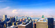 Midtown Manhattan bird's eye view facing west to Times Square theatre district, the Hudson River and beyond to New Jersey. Includes famous buildings - left to right - The New York Times building, Paramount Building with clock showing 9:30, Astor Plaza home to Minskoff Theater, green pyramid top Worldwide Plaza. Snow visible on near rooftops. Distant building signs digitally altered to be blank.  RF