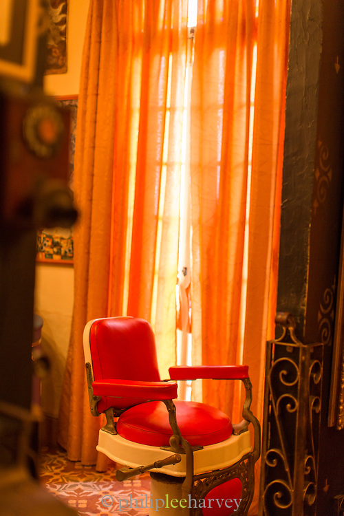 Inside hair saloon with red chair and window, Havana, Cuba
