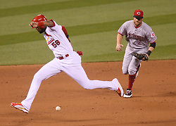 September 12, 2017 - St Louis, MO, USA - The St. Louis Cardinals' Jose Martinez steps over a groundout by Yadier Molina as he advances to third in the fourth inning against the Cincinnati Reds and shortstop Zack Cozart, right, on Tuesday, Sept. 12, 2017, at Busch Stadium in St. Louis. The Cards won, 13-4. (Credit Image: © Chris Lee/TNS via ZUMA Wire)