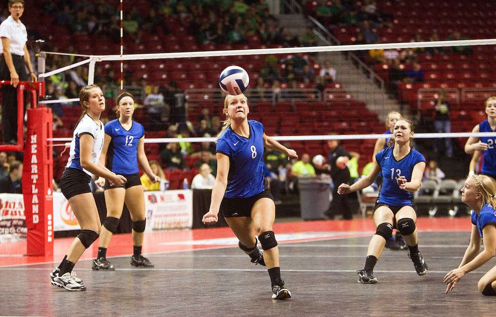 Exeter-Milligan's Jaclyn Luzum attempts to save a ball during their Class D-1 championship match against Guardian Angels Central Catholic Saturday at the Heartland Events Center in Grand Island. Exeter-Milligan won, 25-20, 15-25, 25-13, 25-20. (Independent/Matt Dixon)