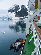 A cruise ship anchors near a tidewater glacier on Paradise Bay, an inlet of the Southern Ocean, Graham Land (the north portion of the Antarctic Peninsula), Antarctica.