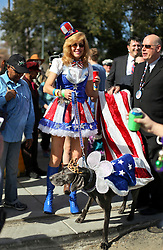 31 January 2016. New Orleans, Louisiana.<br /> Mardi Gras Dog Parade. Kind of Barkus, Alex the Weimarana with Diane Lundeen. The Mystic Krewe of Barkus winds its way around the French Quarter with dogs and their owners dressed up for this year's theme, 'From the Doghouse to the Whitehouse.' <br /> Photo©; Charlie Varley/varleypix.com