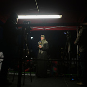 Protesters agains the visit by Saudi prince Bin Salman gather opposite Downing Street March 7th 2018 in London, United Kingdom. A female TV presenter get ready to broadcast for AFAQ TV, an Iraqi tv station.Many are angry at the Saudi involvement and continued bombing in Yemen with tens of thousands of civilian casualties and many more displaced by the war.