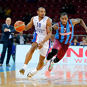Anadolu Efes's Dontaye Draper (L) and Trabzonspor's Dwight Hardy (R) during their Turkish Basketball League Play Off Semi Final round 1 match Anadolu Efes between Trabzonspor at Abdi Ipekci Arena in Istanbul Turkey on Friday 29 May 2015. Photo by Aykut AKICI/TURKPIX