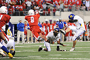 Henderson DB Trey Vallier attempts to block a Chapel Hill point conversion during their UIL 3A Div I Championship game at Cowboys Stadium on Friday.