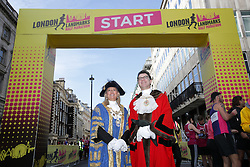 The Right Worshipful Lord Mayor of Westminster Councillor Lindsey Hall (left) and Alderman and Sherriff Vincent Keavney of the City of London at the start line of the 2019 London Landmarks Half Marathon.