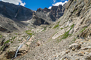 Hikers on the dogleg trail to Chasm Lake on the Longs Peak trail in Rocky Mountain National Park, Colorado.